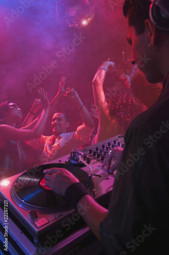 Hispanic dj playing at nightclub