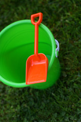 Green Pail With Orange Shovel