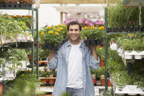 Hispanic man working in plant nursery