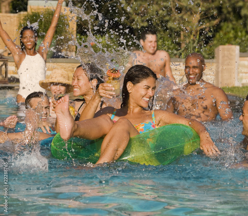 Multi-ethnic friends in swimming pool