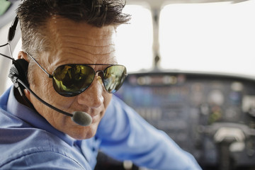 Man in cockpit of airplane
