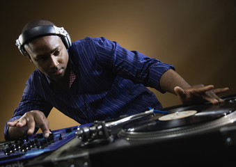 African American male dj spinning records