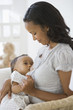 African American mother breastfeeding baby