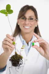 Maltese female scientist holding plant and medication