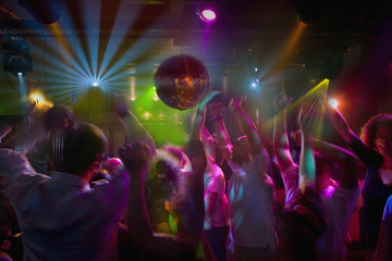 Multi-ethnic people dancing at night club