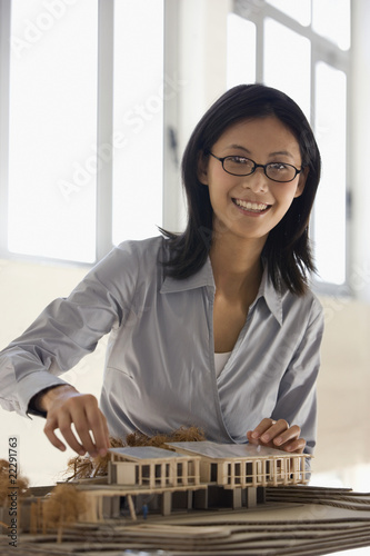 Asian female architect building model