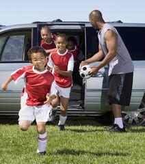 Multi-ethnic children in soccer uniforms
