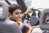 Middle Eastern teenaged boy in car