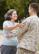 Hispanic male soldier greeting mother