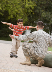 Hispanic military father greeting son