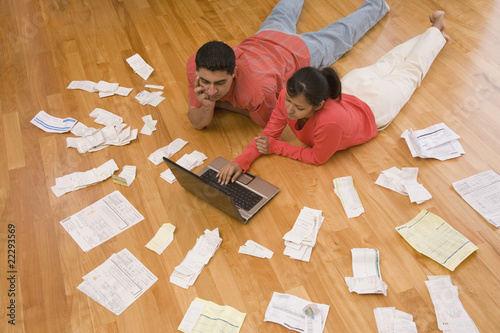 Hispanic couple paying bills