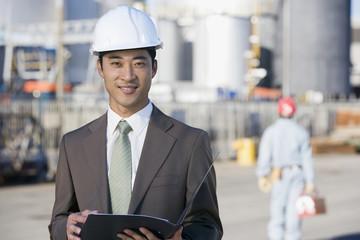 Asian businessman wearing hardhat