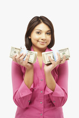 Asian woman holding stacks of money