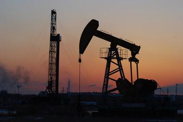 Oil rigs silhouette over orange sky-4