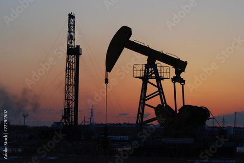 Oil rigs silhouette over orange sky-4 - 22294502