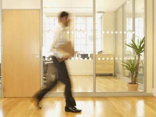 Blurred motion shot of Indian businessman walking