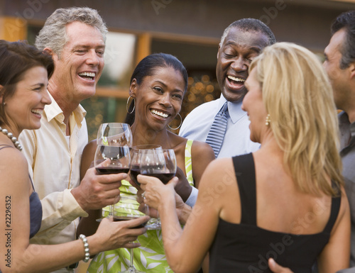 Multi-ethnic friends toasting with wine