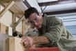 Hispanic man working in wood shop