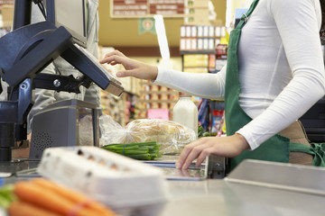 Cashier ringing up groceries