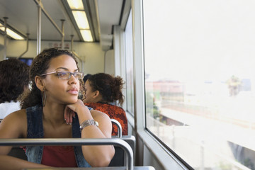 African woman riding on train