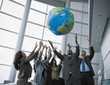 Multi-ethnic businesspeople playing with globe ball