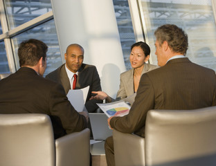 Multi-ethnic businesspeople having meeting