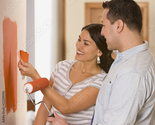 Hispanic couple looking at paint swatches
