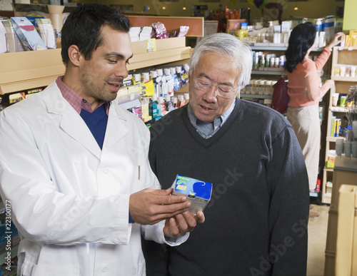 Pacific Islander pharmacist assisting customer