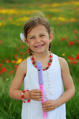 Pretty young girl posing with her recorder