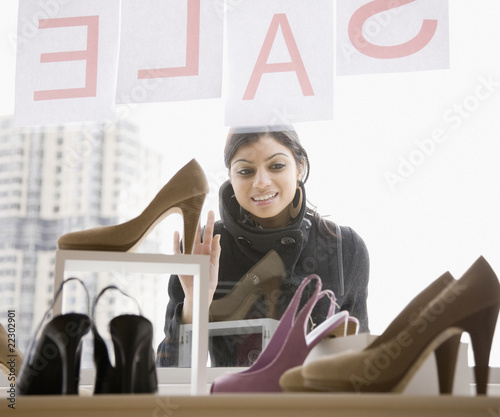 Mixed Race woman shoe shopping