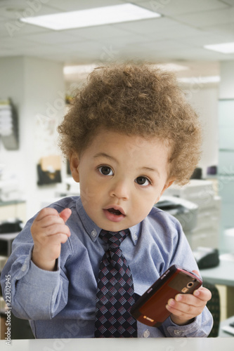 Mixed Race baby dressed like businessman
