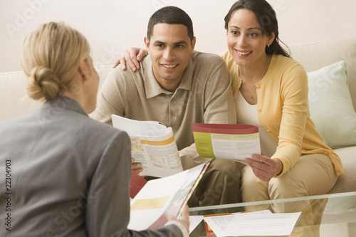 Hispanic couple receiving financial consultation