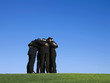 Business people huddling outdoors in grass