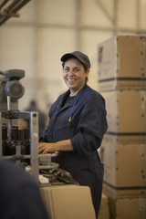 Hispanic woman working in bottling factory