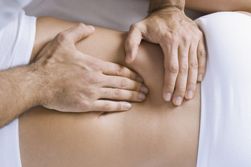 Chiropractor adjusting womanÕs spine