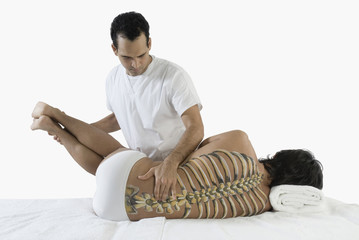 Chiropractor adjusting manÕs back