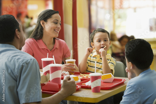 Hispanic family eating in fast food restaurant