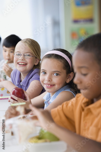 Students eating healthy lunch in cafeteria