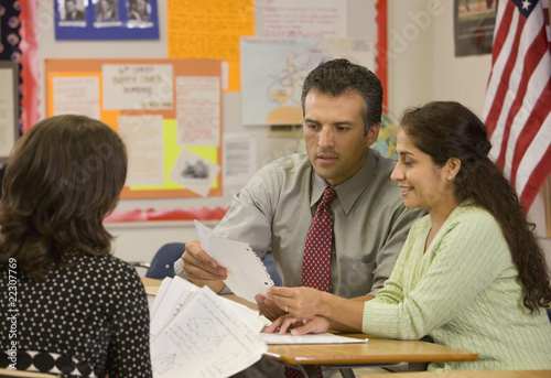 Teacher talking to parents at parent teacher conference