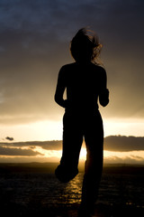 woman running forward silhouette