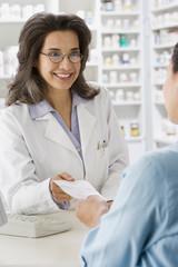 Hispanic pharmacist filling prescription