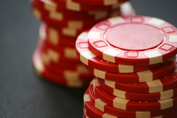 Two piles of red casino chips