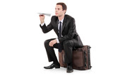 A business traveller holding a paper toy plane poster