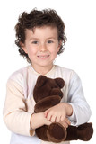 Pretty boy in pajamas with teddy bear poster