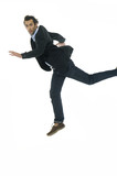 Portrait of a happy businessman jumping in air