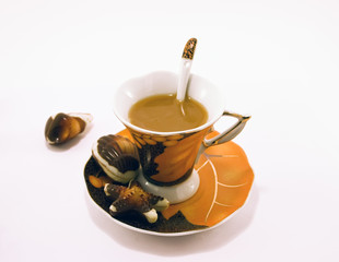 Cup of coffee and chocolate candies