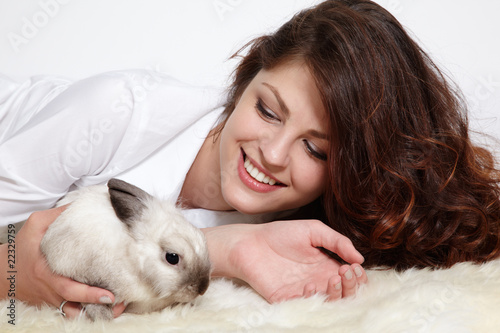 Girl and pygmy rabbit