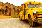 Old rusty school bus abondoned in desert