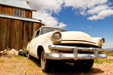 Old classic car in desert