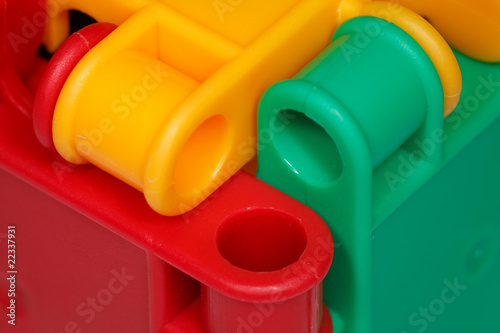 Colored plastic toys closeup, elements of design.